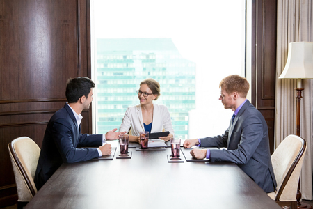 Business Partners Negotiating in Conference Room
