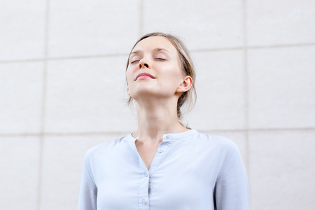 Photo for Relaxed young woman feeling spiritual energy - Royalty Free Image