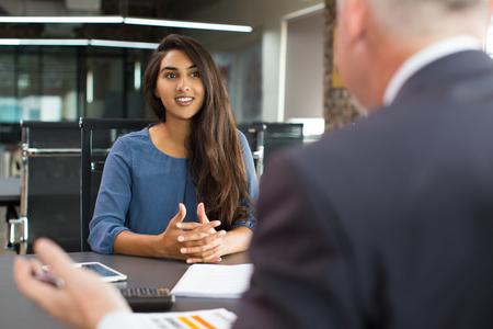 Photo pour Smiling female client talking to male manager - image libre de droit