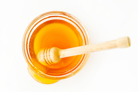 Photo for Dipper in Bowl with Honey and Splash - Royalty Free Image