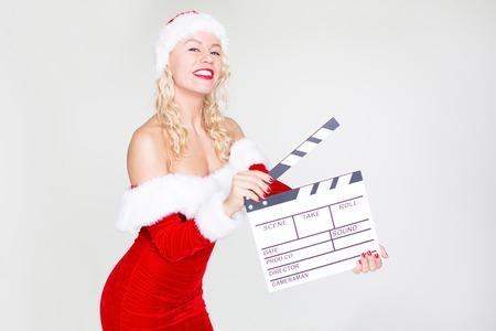 Foto de Happy woman in Santa costume with clapperboard - Imagen libre de derechos