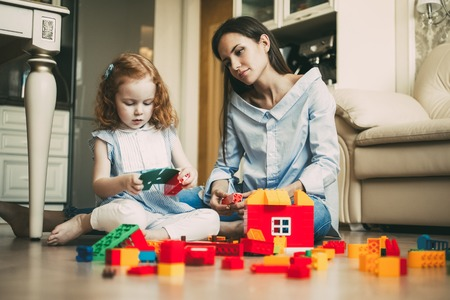 Photo for Curious little girl and mother playing together - Royalty Free Image