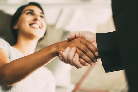 Photo pour Closeup of Business Woman Shaking Partner Hand - image libre de droit