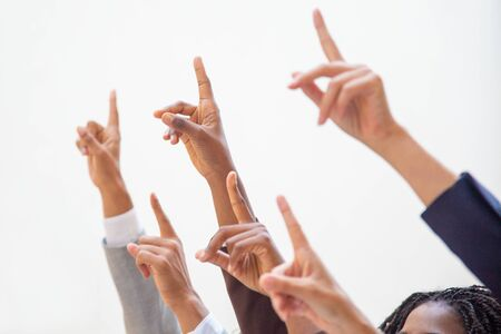 Photo for Business people raising hands and pointing index fingers up. Isolated arms on white background. Training concept - Royalty Free Image