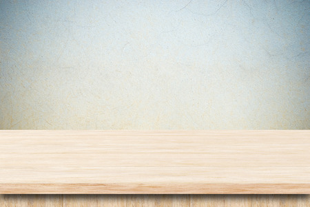 Photo for Empty wooden table over grunge cement wall. - Royalty Free Image