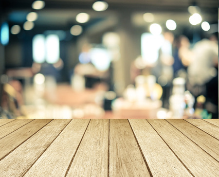 Pespective wood over blurred restaurant with bokeh background, foods and drinks, product display montage