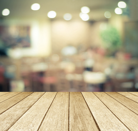 Perspective wood over blurred restaurant with bokeh background, foods and drinks, product display montage