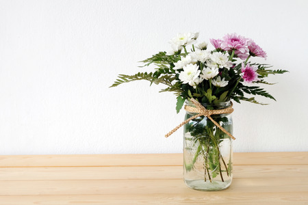 Photo for White and pink daisy bouquet in mason jar on table background, fresh flower - Royalty Free Image