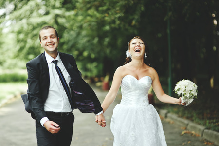 Foto de Newly wed couple going crazy. Groom and bride together. - Imagen libre de derechos