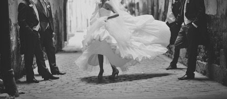Photo pour Happy bride dancing around boys. Wedding day - image libre de droit