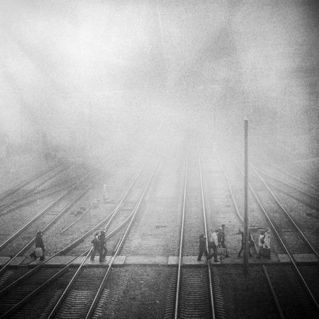 Foto de train station with passenge, grunge grainy vintage photo - Imagen libre de derechos