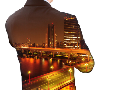 Isolated double exposure of businessman in suit and cityscape at night. He's looking for his success in business and idea for life