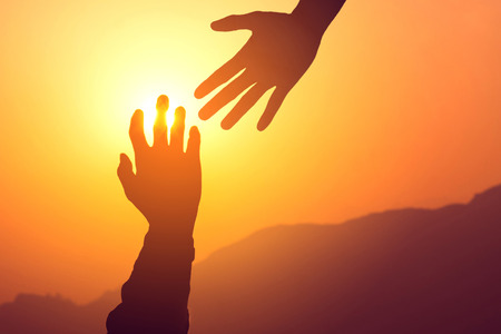 Foto per Helping hands concept. Silhouette of hands help and hope and support each other. - Immagine Royalty Free