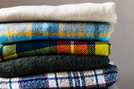 Photo for Stack of woolen checked blankets, autumn and winter concept - Royalty Free Image