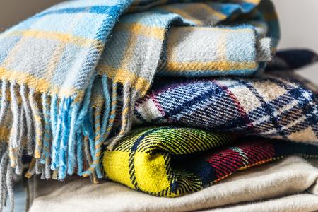 Photo pour Stack of woolen checked blankets, autumn and winter concept - image libre de droit
