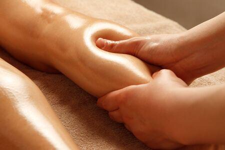 Foto de Esthetician's hand sheds calf lymph in beauty salon - Imagen libre de derechos