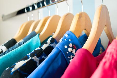 Foto de Different clothes on hangers close up - Imagen libre de derechos