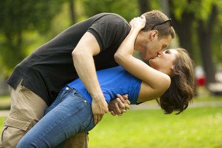 Young couple in love outdoorin lovekissing and embracing