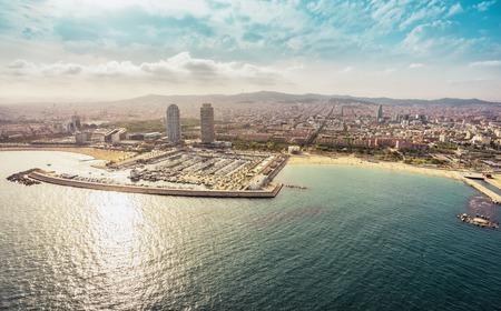 Foto de Barcelona skyline aerial view with skyscrapers by the beach, Spain. Vintage colors - Imagen libre de derechos