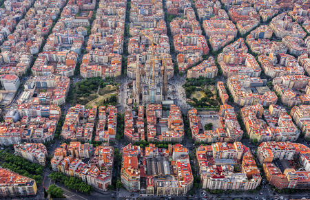 Foto de Aerial view of Barcelona Eixample residencial district, typical urban squares, Spain. Late afternoon soft light - Imagen libre de derechos