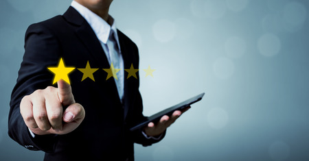 Foto de Review and rating increase company concept, Businessman hand touching five star - Imagen libre de derechos