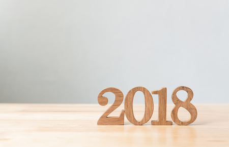 Photo pour Happy new year 2018, Number wood material on wooden table with white wall background, Copy space - image libre de droit
