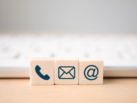 Foto per Wood block symbol telephone, mail, address and mobile phone. Website page contact us or e-mail marketing concept - Immagine Royalty Free