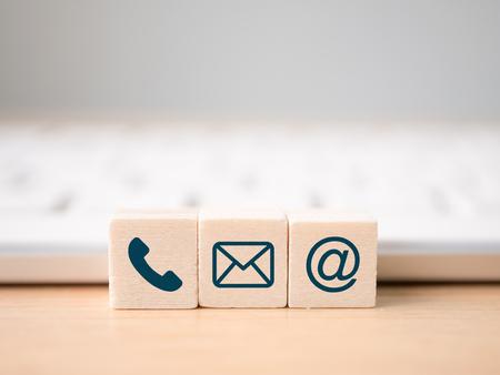 Photo pour Wood block symbol telephone, mail, address and mobile phone. Website page contact us or e-mail marketing concept - image libre de droit