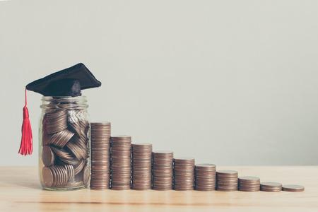 Foto de Scholarship money concept. Coins in jar with money stack step growing growth saving money investment - Imagen libre de derechos