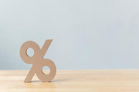Foto de Percentage sign symbol icon wooden on wood table with white background - Imagen libre de derechos