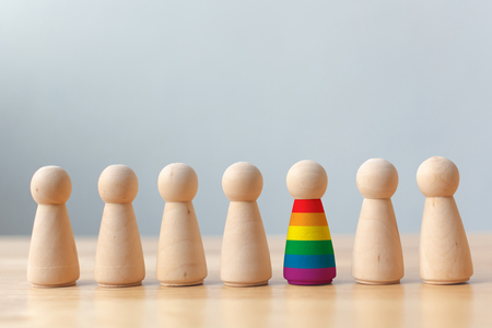 Photo for Human rights of LGBT campaign concept. Wooden dolls with rainbow colors are different stand out from crowd - Royalty Free Image