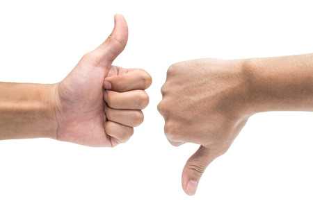 Foto de Thumb up and thumb down hand signs isolated on white - Imagen libre de derechos