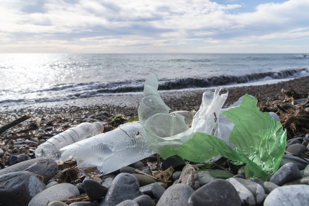 Photo pour Marine pollution: plastic waste on the beach. - image libre de droit
