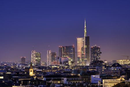 Photo for Milan skyline by night, new skyscrapers with colored lights. Italian landscape panorama. - Royalty Free Image