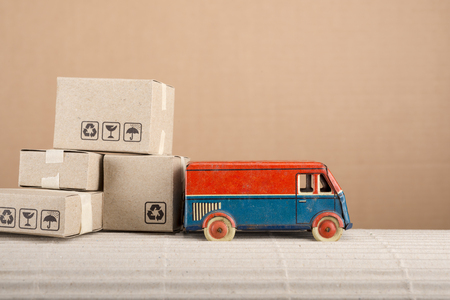 Foto per Vintage toy truck with cardboard boxes. Shipping and delivery concept. - Immagine Royalty Free