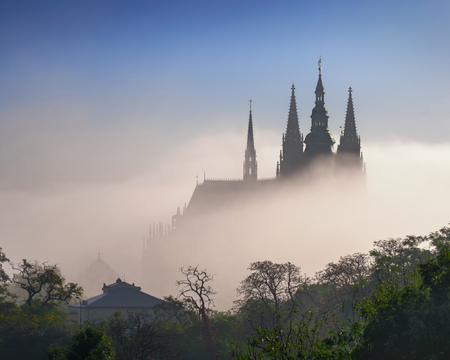 Photo for Fog waves over St. Vitus Cathedral during autumn, Czech republic. - Royalty Free Image