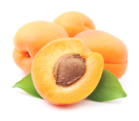 Photo for Sweet apricots fruits with leafs on white - Royalty Free Image