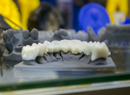 Foto de The lower jaw man, created on a 3d printer from a photopolymer material. Stereolithography 3D printer, technology of liquid photopolymerization under UV light. Modern additive and medical technologies - Imagen libre de derechos