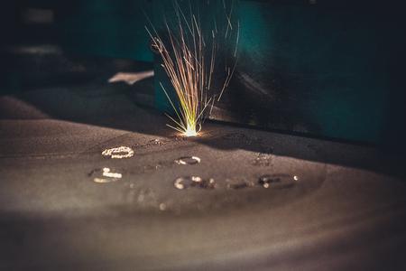 Foto de 3D printer printing metal. Laser sintering machine for metal. Metal is sintered under the action of laser into shape. DMLS, SLM, SLS. Modern additive technologies 4.0 industrial revolution. Sparks - Imagen libre de derechos