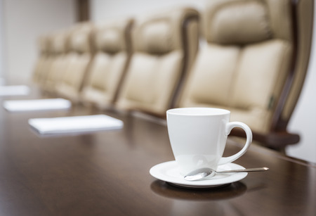 Photo for Closeup of  on table in empty corporate conference room before business meeting in office - Royalty Free Image