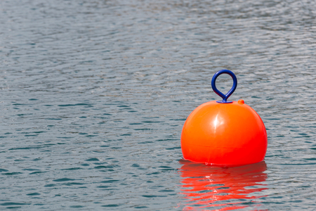Photo for Red Buoy for safety swimming in water - Royalty Free Image