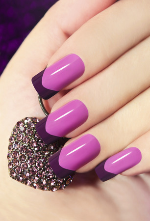 Photo pour 	   Two-tone French manicure pink and purple with decoration in the form of heart  - image libre de droit