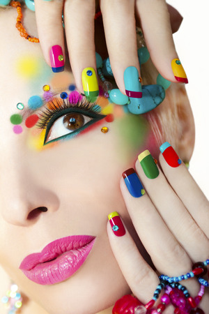 Photo pour Colorful French manicure and makeup on the girl with rhinestones. - image libre de droit
