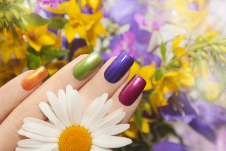 Colorful manicured nails square shape with flowers.
