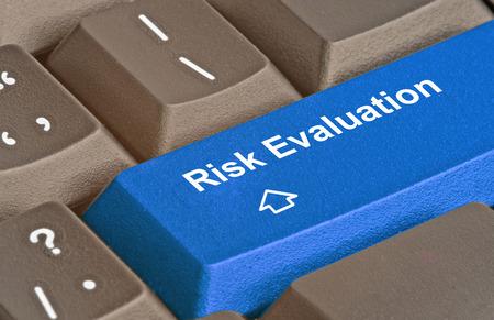 Foto de Keyboard with blue key for risk evaluation - Imagen libre de derechos