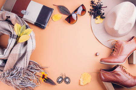 Photo for Autumn female outfit. Set of clothes, shoes and accessories on brown background - Royalty Free Image