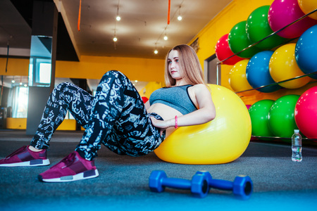 Photo for Shot of young woman exercising at the gym. Muscular female training using a ball. Woman doing sit-ups in the morning. - Royalty Free Image