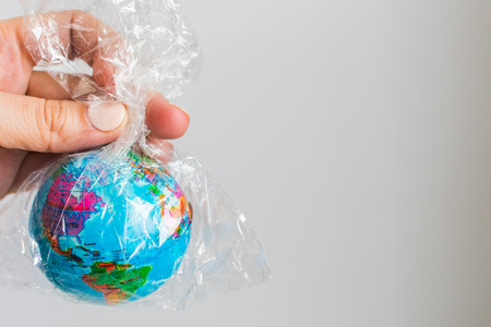 Photo pour small globe of Earth in a plastic bag. The concept of the pure Earth - image libre de droit