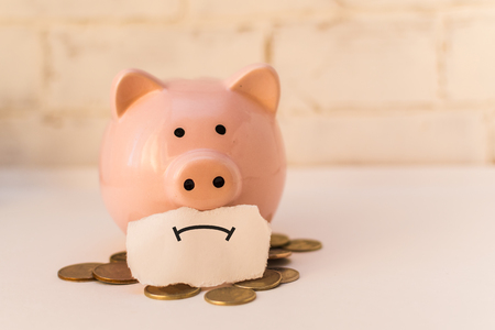 Photo for pink piggy Bank is sad. The concept of poverty - Royalty Free Image