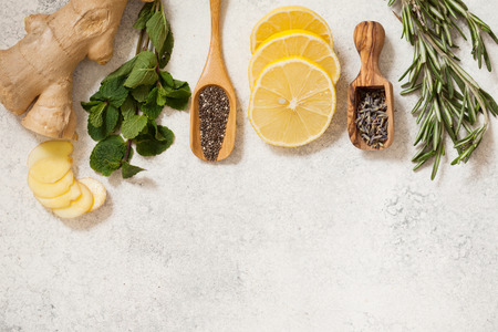 Foto de Organic ingredients for detox healthy drink. Mint, rosemary, honey, ginger, lemon, chia and lavender seeds top view with place for text - Imagen libre de derechos